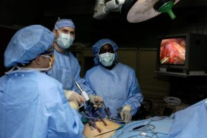 050131-F-1936B-008 Doctors Ronald Post (left) and John Smear (center) and Physician's Assistant Debra Blackshire perform laparoscopic stomach surgery at Langley Air Force Base, Va., on Jan. 31, 2005.  The surgery will involve the removal of the gall bladder to help alleviate acid reflux disease.  DoD photo by Staff Sgt. Samuel Bendet, U.S. Air Force.  (Released)